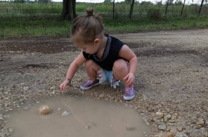 My daughter playing in the mud after the rain